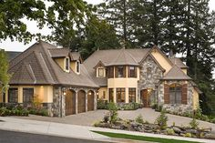 wrap around driveway, L-shaped house, stone work on house