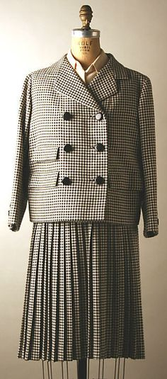 Black and white checked suit with sleeveless white silk blouse (with jacket), by Norman Norell, American, fall/winter 1964-65.