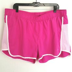 """Old Navy Plus Size 2X Swim / Active Shorts These Old Navy Plus Size 2X Swim / Active Shorts are in great used condition, like new. They're lined inside for swimming. Bright pink (fuchsia) with white trim. Waist measures 20"""" across laying flat, unstretched; stretch to 24"""" across--so up to 48 inches around. 3.5"""" inseam. 100% polyester. ::: Bundle 3+ items from my closet and save 30% off when you use the app's Bundle feature! ::: No trades. Old Navy Swim"""