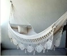 hammock.  I have a lace coverlet that  might work for this!