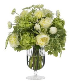 """Inspired by the flowers in Downton Abbey, this elegant mix of dahlias, roses, hydrangea and snowball viburnum fills a delicate footed vase. 11"""" diameter x 15"""" tall."""