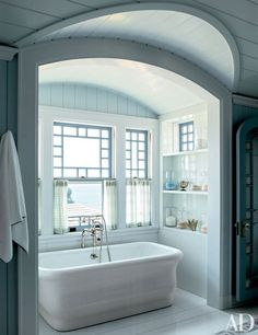 In the master bath, the tub and its fittings are by Waterworks