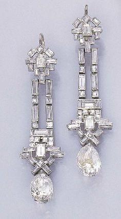 A PAIR OF ART DECO DIAMOND EAR PENDANTS   Each designed as a baguette and square-cut diamond flexible band of geometric motif suspending a briolette-cut diamond, circa 1925