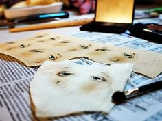 she paints the faces on first before sewing them on