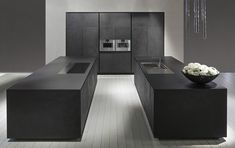 Black cement kitchen with monolithic island: One by Rifra