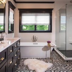 Artistic Tile | Hydraulic Black | We can't stop staring at this master bathroom designed by Donna Mondi Interior Design! The bold contrast of black and white Hydraulic porcelain tile on the floor commands attention in this urban oasis.