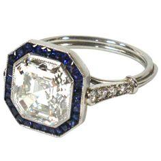 An Art Deco Asscher Cut Diamond and Sapphire Engagement Ring