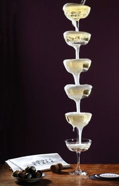 Coupe-Stack: 1 bottle of bubbles + 6 glasses = a lovely & delicious display from #DrinksBusiness