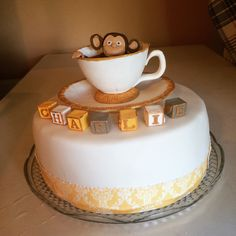 Curious monkey in a tea cup. Christening cake.