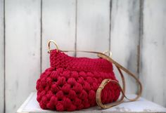 A stunning bag. High aesthetic design and lovely yarn endowed this bag with irresistible attraction.   The bag is woven with a vivid and sweet fuchsia 100% cotton yarn.  The long and chic strap is made by natural cork with gold finishing touches. It's length is adjustable with gilded metal fastener.  Height 20cm Length 32cm Width 23cm  Price: 140€