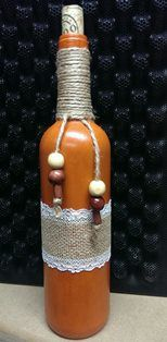 Orange chalk painted bottle with jute, burlap and beads