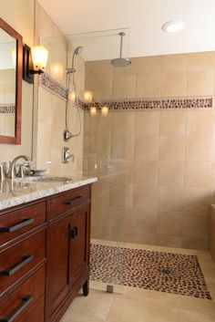 I like how the floor tile matches the stripe on the wall. Maybe make a backsplash for the sink area in same tile?