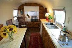 Airstream guesthouse with a main level large bed, feels private with the built in nook divider.