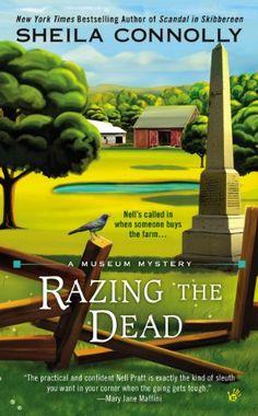 Razing the dead / Sheila Connolly.
