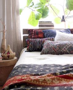 bed / bedroom / fabric / cushions / plant -- boho bohemian gypsy hippie vintage interior design home decor neutral, pillows, sheets, linens bedding bedroom style blankets sheets moroccan marrakech oriental
