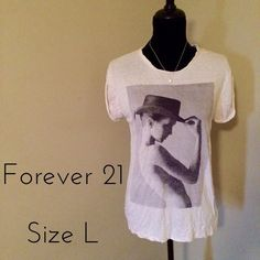 Trendy slouchy black and white graphic tee Perfect with leggings!! Sleeves have a unique roll back design (see photo). Small hole on one sleeve (see last photo) - willing to accept offers! Forever 21 Tops Tees - Short Sleeve