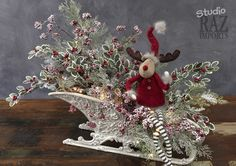 Decorating ideas from the RAZ Aspen Sweater Collection using one of the larger elves and knitted ornaments. Christmas Sled, Christmas Projects, Winter Christmas, Christmas Holidays, Christmas Wreaths, Christmas Ornaments, Family Holiday, Holiday Ideas, Christmas Flower Arrangements