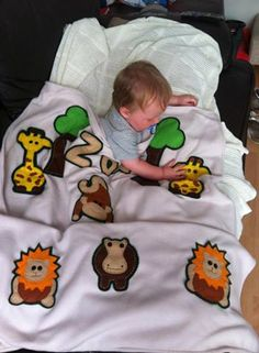 Zak playing with the animals - loving the Giraffes!  Buy this blanket @ www.minimixkidsdesigns.co.uk Or link our Facebook Page and Visit our Shop - or Email us @ minimixkidsdesigns@gmail.com