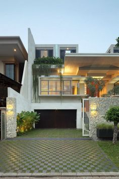 """Static House was designed by Jakarta-based studio TWS & Partners and is a diverse 7,530 square foot contemporary home in Jakarta, Indonesia. The client's brief in this case implied the construction of an opulent """"garden house"""", a crib that would communicate well with the exterior."""