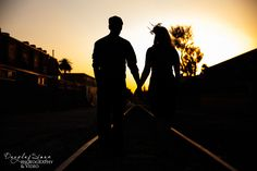 our vintage couple on the railroad tracks at sunset