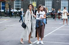 The Best of London Street Style - LFW Street Style Photos Spring 2015 - Elle. looks like someone just rolled out of bed and forgot that she would have her picture taken. The white sneakers do not match with her skirt, and the sport logo shirt does not either. And the sweater tied around the waste...So unclassy. Her outfit needs reworking such and eye sore. And that long trench with bare legs screams naked guy who loves to flash people as they walk by or a guy selling watches that he…