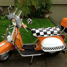 Genuine Stella scooter with checkers galore! This customer not only has our scooter seat cover and matching strap, but also came back for a backrest cover in checkers for his topcase!