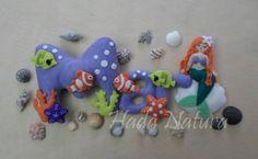 Nombre de fieltro para Mar, decorado tal y como el propio nombre indica. Todos los detalles en el blog: http://hadanatura.blogspot.com.es/2014/02/mar.html  #mar #fieltro #bebé #nombre #sirenita