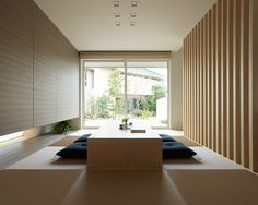 Floor-to-ceiling fusuma (sliding partition) on right, tschubai (alcove) on left, enhancing layered affect.