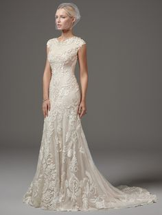 Sottero and Midgley - SUZANNE ROSE, This unique and glamorous fit-and-flare features laser-cut lace over textured netting and Viva jersey lining with a jewel neckline and modest cap-sleeves trimmed with lace appliqués. Finished with zipper closure.