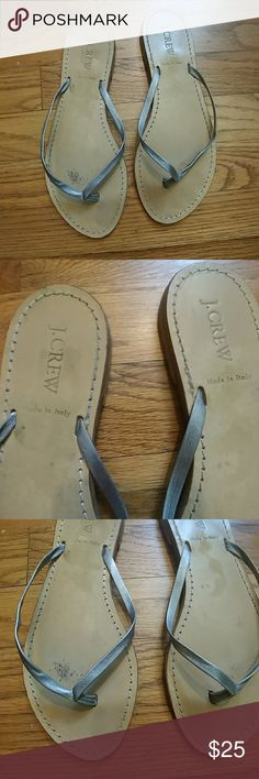 J. Crew Rio metallic silver flip flops J. Crew Rio leather flip flops in Metallic Silver.  Features a super tiny heel (approx. 1 cm stacked), leather uppers, made in Italy.  Size:  8  In very good used condition.  Please note there are signs of wear on the upper insoles (see picture #3) and wear on the bottom soles (see pictures #4 & #5.) J. Crew Shoes Sandals