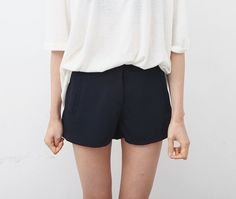 Black shorts and oversized white tee #style #clothes