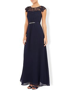 Briar-Rose maxioccasion dress is crafted with a sweetheart bodice with a sheer lace neckline and sequined belt