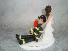 Yep....that would be about right!! lol  Bride Dragging Groom Custom Firefighter Cake Topper by mudcards, $130.00