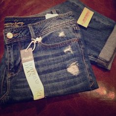 "American Rag Boyfriend Jeans American Rag Distressed Boyfriend Jeans. Loose relaxed boyfriend fit. Cute Distressed areas with navy paisley print. 27"" uncuffed inseam. Sizes 0, 3, 5, 7 available. Please comment size & I'll make you a new listing for purchase.  tradesPP ✅Bundle & SAVE! American Rag Jeans Ankle & Cropped"