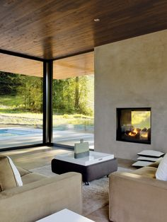For this home in Sonoma, California, two linked 1,000-square-foot pavilions create dynamic indoor-outdoor space. The home, completed in spring 2012 by architects Leslie and Julie Dowling, identical twins and protégées of Michael Graves, decked out the house in neutral tones, from fireplace surround to furnishings, to let the outdoors take center stage. photo by: Matthew Millman