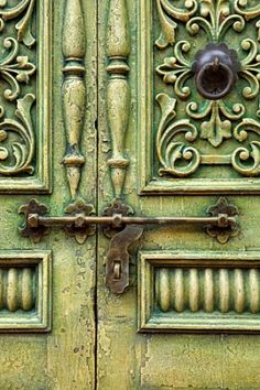 Photographer ~ Laura Tharp. A wonderful old door in antique green paint - These old doors were found in Santa Fe, New Mexico, but they could have been found in some other exotic place – many are imported for use in the adobe homes in Santa Fe. I loved how the softened hues of paint created a texture on the whole door, and the patina on the brass lock added to the feeling of antiquity. I positioned myself to frame the 'seam' of where the doors joined off-center, to keep the picture more…