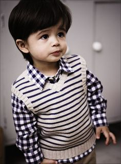 This is a vest in oyster shade with navy blue stripes over it and a chunky rib knit trim. Turn your boy into a fashion forward kid with this.