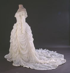Wedding dress made from the parachute that saved the grooms life