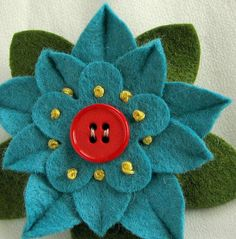 Turquoise Felt Flower Pin with Dark Orange by #dorothydesigns #CyberMonday Sale - Shop handmade for the holidays - use code CYBERSFETSY  etsy.com