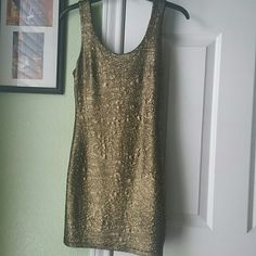 Gold shimmer dress Never worn! New without tags. Taken off to wash dress. Very stretchy material, will fit like a bodycon. Super cute though for a night out.  Size is small. Excellent condition :) *brand used for exposure not F21* Forever 21 Dresses Mini