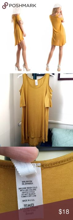 """Cold Shoulder Tunic Hi- Lo Mustard NWOT Col shoulder tunic! Hi- lo. NWOT from boutique! Can be worn as a dress or top! I wore it with leggings in the pic. Mustard color. Made in USA. Measurement: Small: 17.5 inches bust, 28"""" long, back lenght 30"""". Medium: 18""""bust, 30""""long and back length 32"""". Large:19""""bust, 31""""long and back length 33"""". Also available in sky blue. See other listing. Tops"""