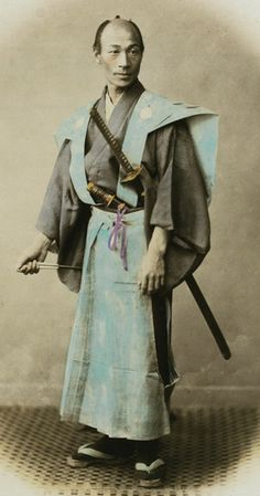Portrait of a former Samurai.  Hand-colored photo taken in the 1870's, Japan, a few years after the abolishing of the Samurai by the command of the Emperor.  Photographer Felice Beato. S)