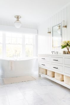 a bathroom storage ideas // baskets under the vanity