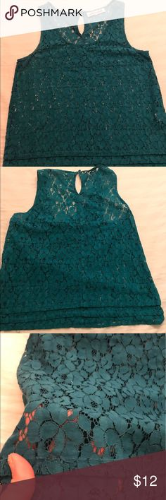 Teal Floral Top. BOGO FREE SALE ENDING SOON!! NWOT. Just tried on never worn. Deep gorgeous Teal color. See thru floral design. Key ring closure on back. Very sexy. May fit right on belly button or slightly cropped. Wear alone or cami underneath. BOGO FREE SALE ENDING SOON. BUY ONE GET ONE FREE, ANYTHING IN MY CLOSET. PAY HIGHER PRICE. Tops Blouses