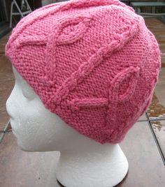 Free Knitting Pattern for Pink Ribbon Hat - This beanie features six cabled ribbons, separated by mini cables that work their way all the way up to the crown and join in the center. This hat could easily be made in a different color to support various causes. Designed by Carissa Browning. Pictured project by SandyHam