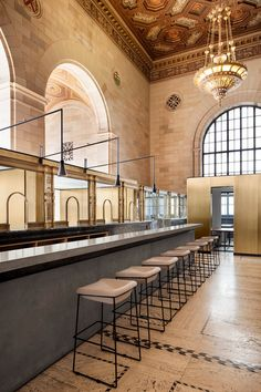 Henri Cleinge Architecte adapts former Royal Bank space on St-Jacques street in Old Montreal for Crew Offices and Café #coffeeshop #gold