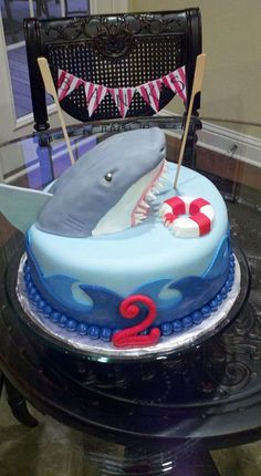 cake covered in fondant with fondant waves. Shark sculpted from vanilla pound cake and covered in fondant. Hand painted pennant-banner with birthday boy's name. Shark Birthday Cakes, Boy Birthday Parties, 2nd Birthday, Birthday Ideas, Shark Cake, Shark Shark, Shark Party, Its My Bday, Cake Cover