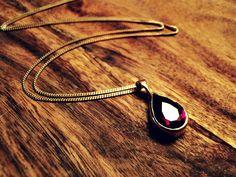 Gold plated sterling silver, pear cut garnet pendant. Elke Marie Frerichs