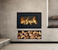 Find your new fireplace in a beautiful design that creates a warm centrepiece in your home. Get Scandinavian quality with a fireplace insert - RAIS Fireplace Decor, Inset Stoves, Stove, Inset Fireplace, Wood Burning Fireplace Inserts, Fireplace Wall, Fireplace Showroom, Living Room With Fireplace