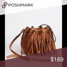 Fringe micro Lexi bucket by Rebecca minkoff So on trend!! This mini crossbody bag is perfect to carry all your essentials for the day! Neutral color goes with everything and will look good all year long! Soft buttery leather feels so luxe. Brand new with tags Rebecca Minkoff Bags Crossbody Bags
